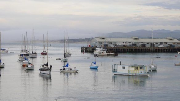 The end of Wharf 2, still with working fisheries, and the opening of the harbor with lots of boats on moorings