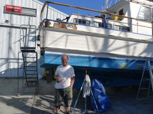 Richard showing off the dry rot he excavated and will be repairing. The boat will look great!