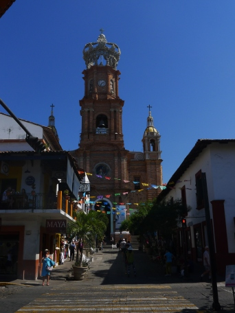 A city's beloved icon: Our Lady of Guadalupe Cathedral in the center of Puerto Vallarta. The crown atop the bell tower (yes, the bells toll the hours) is wrought iron, designed after one worn by the Empress Carlota of Mexico.