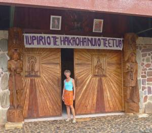 """Beautifully carved hardwooddoors lead in to the sanctuary. """"The Gate of the Loving God"""" hangs above in Marquesan"""