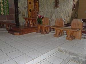 Hand carved seats either side of the alter and pulpit.
