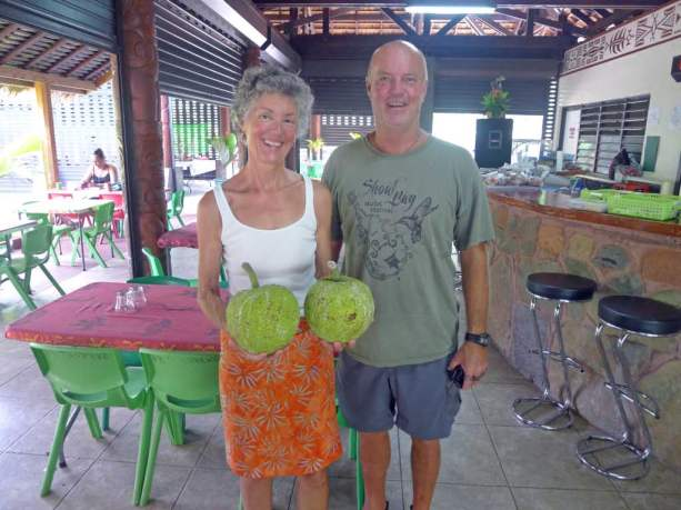 Ruth and cruising friend Greg with two breadfruit for our galley. Yum!