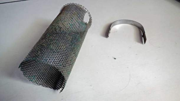 Raw water strainer basket corrosion. The strainer keeps small crabs, jellyfish, and debris from clogging the engine cooling system. This is now a high priority to replace!