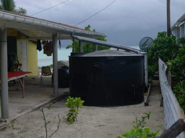 Notice the satellite disk behind the water cisterns. Most houses, even the most modest, have satellite TV.