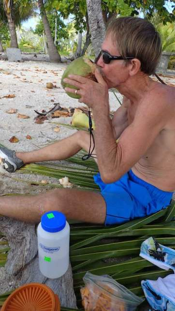 We brought water and snacks from the boat when we went ashore, but Randy couldn't resist cutting down a fresh coconut or two!