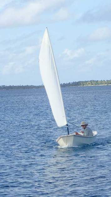 Randy sailing the dinghy.