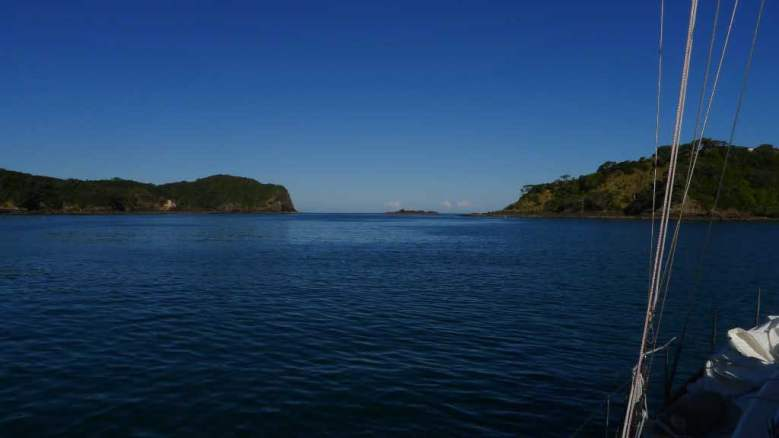 Entrance to Tutukaka Harbor is to the left of the rocks in the middle. The entrance is smaller than it appears in this photo.