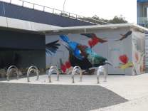 Below the bridge is a car park/camper park, with restrooms. The artwork on the restroom building depicts New Zealand birds.