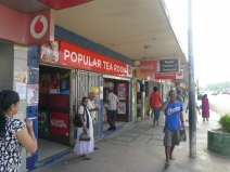 Many small shops line main street in downtown Labasa.